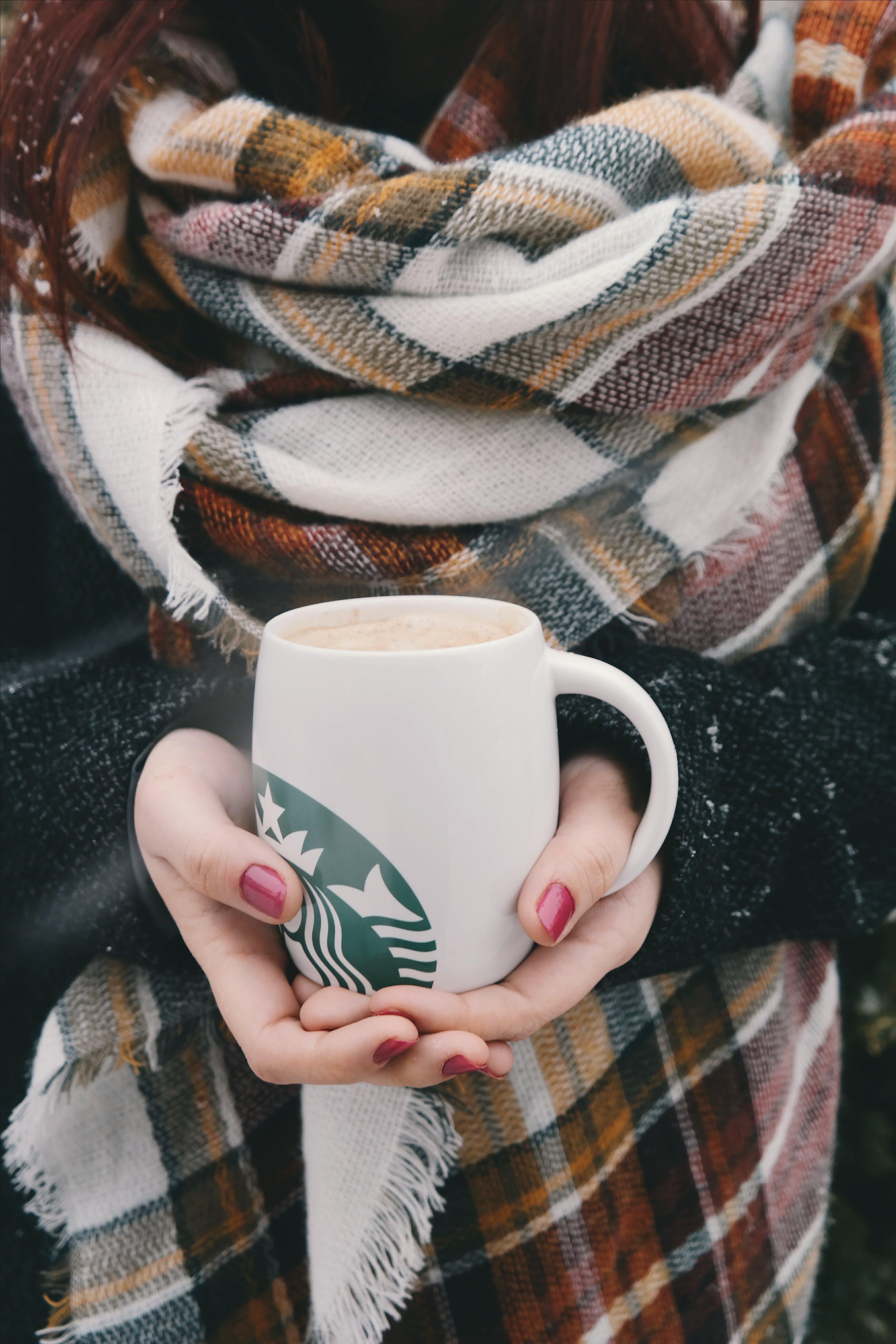 Person Holding White Starbucks Mug