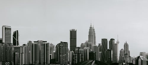 Gray scale Photo of High-rise Buildings