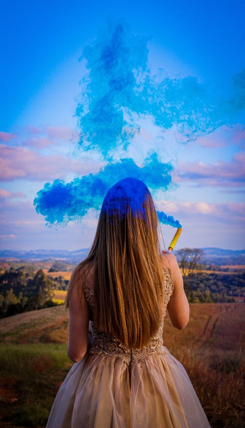 Woman Holding Blue Colored Smoke