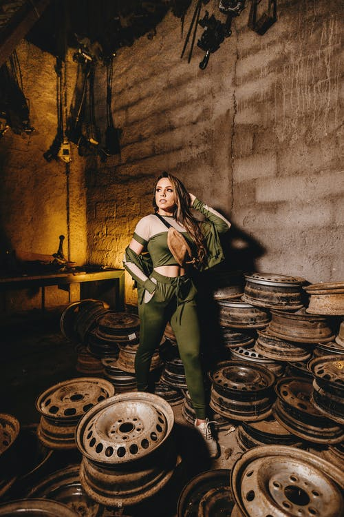 Woman Posing Inside A Room Of Vehicle Rims