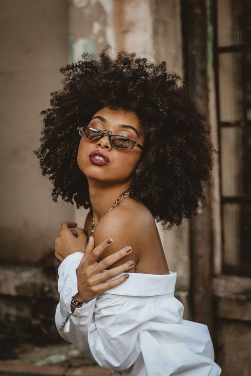 Portrait of Woman with Curly Hair and Sunglasses