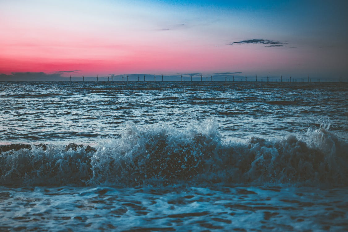 Scenic Photo Of Beach During Dawn