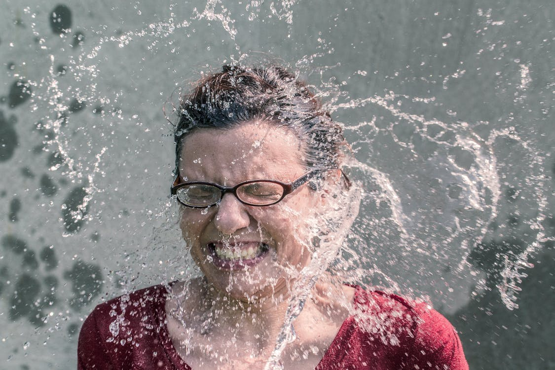 Water Splashing to Woman's Face