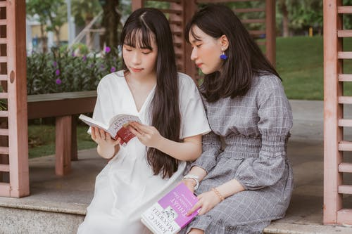Photo Of Women Reading Books