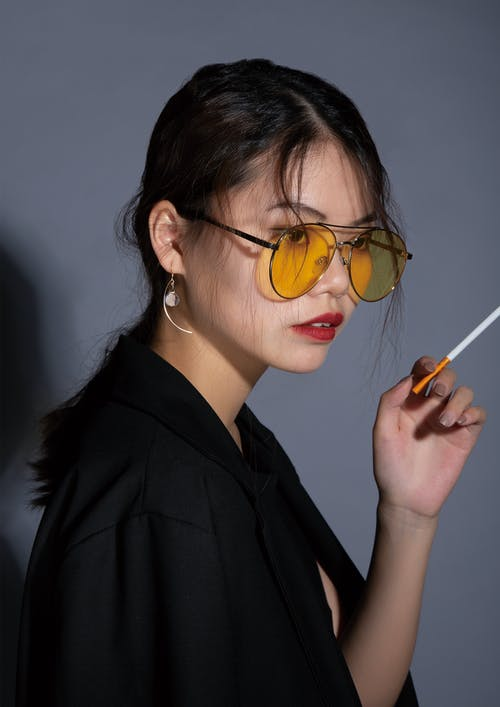 Woman Holding Cigarette