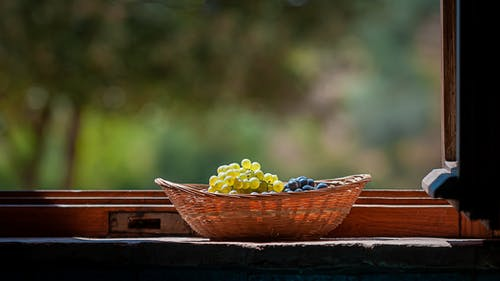 Grapes in Basket on Windowsill