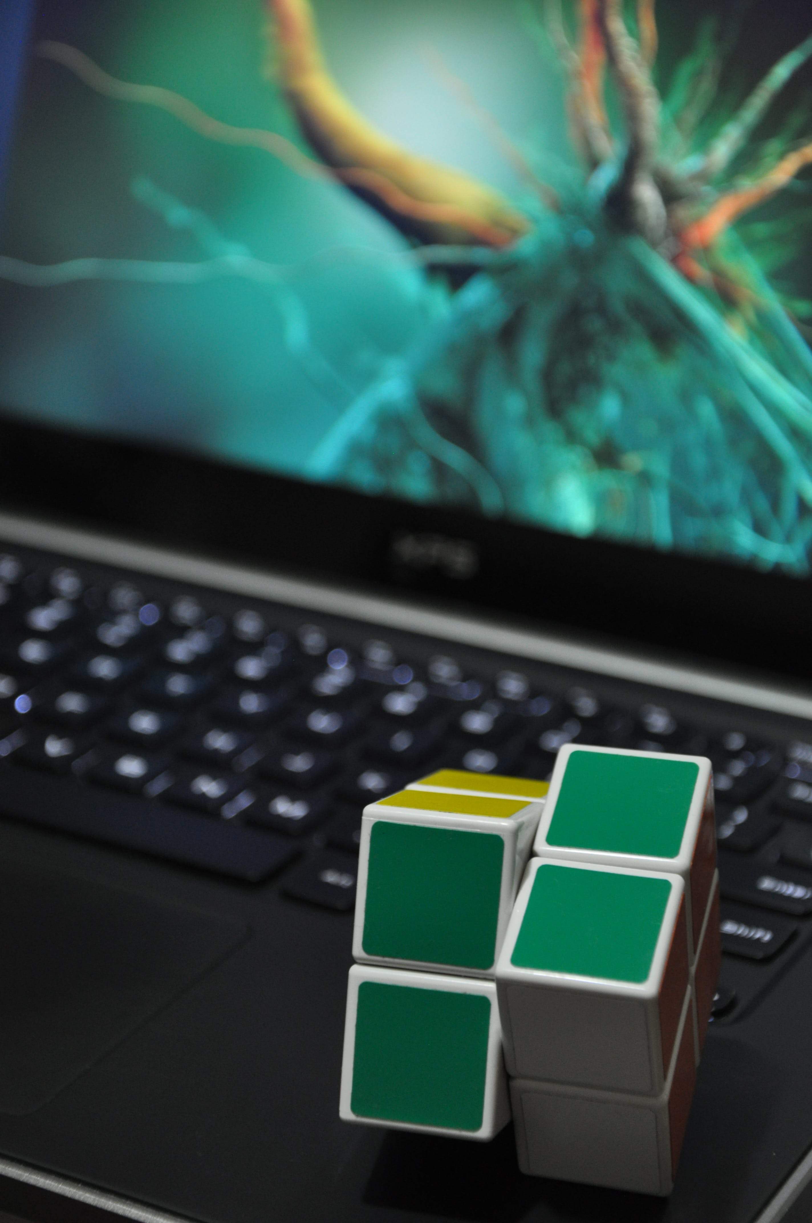 Green and Blue Rubik's Cube Toy