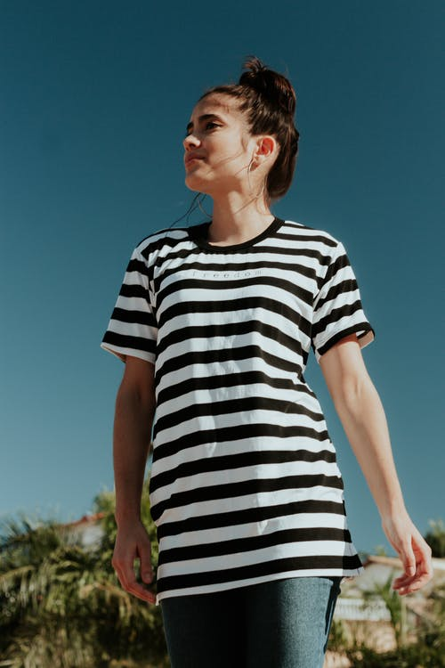Woman Wearing White and Black Striped Crew-neck T-shirt