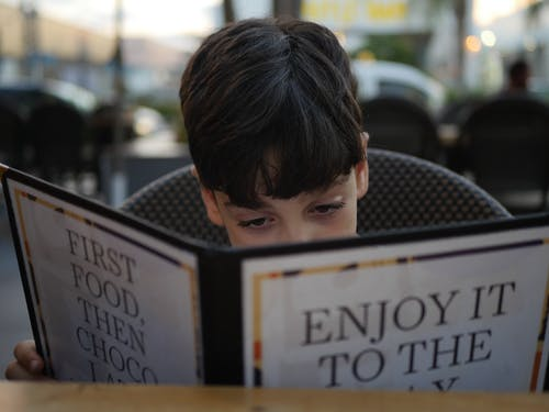 Free stock photo of boy, menu, restaurant