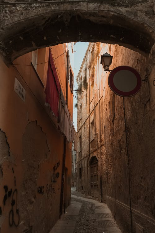 Photo of Narrow Alley In Between Buildings