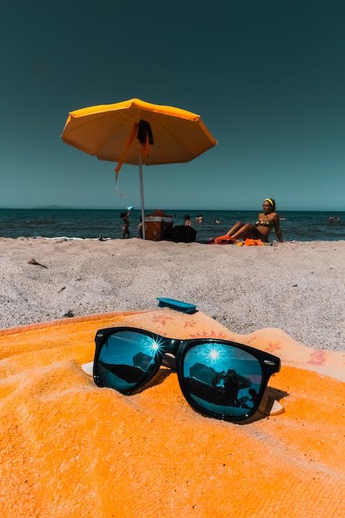Black-framed Blue Sunglasses on Orange Textile