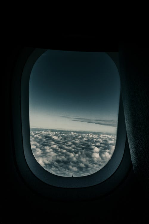 Sea of Clouds Through Airplane's Window