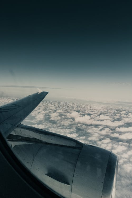 Photo Of Clouds Through An Airplane Window