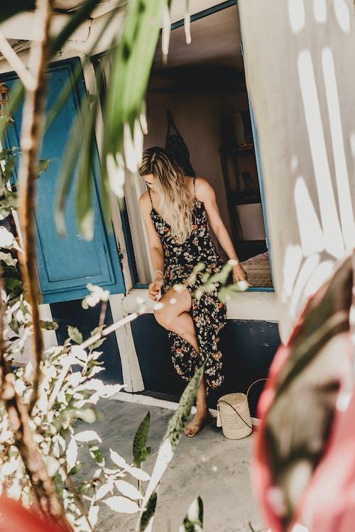 Photo Of Woman Sitting On Cabin Floor