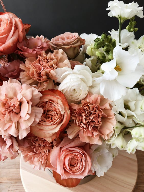 Elegant bouquet of floribunda flowers on floor