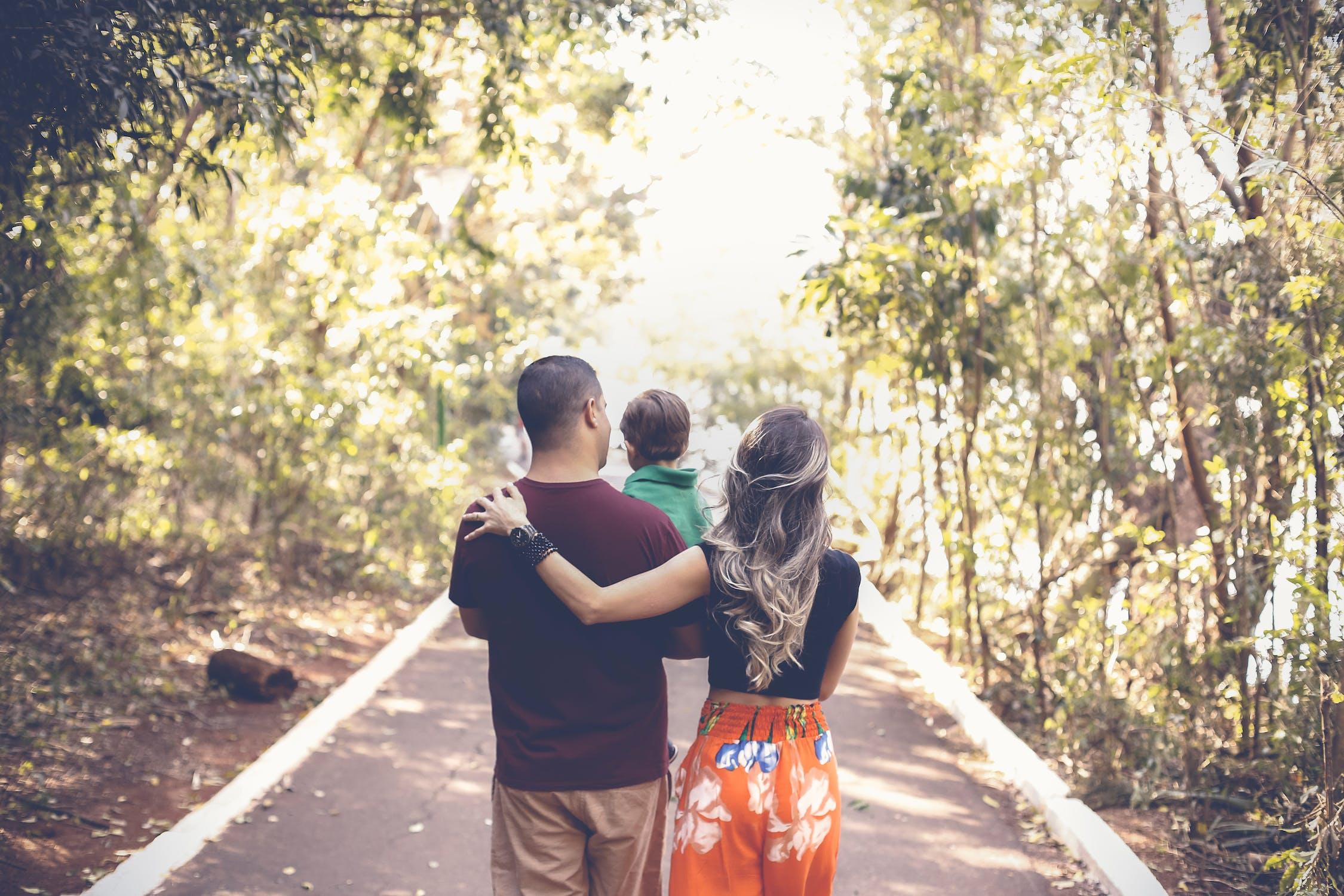 Family walking in park Photo by Vidal Balielo Jr. from Pexels