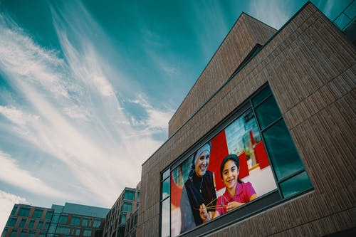 A Giant Screen On A Building Wall