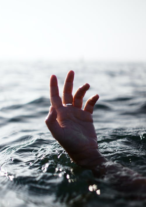 A Human Hand Off The Water's Surface