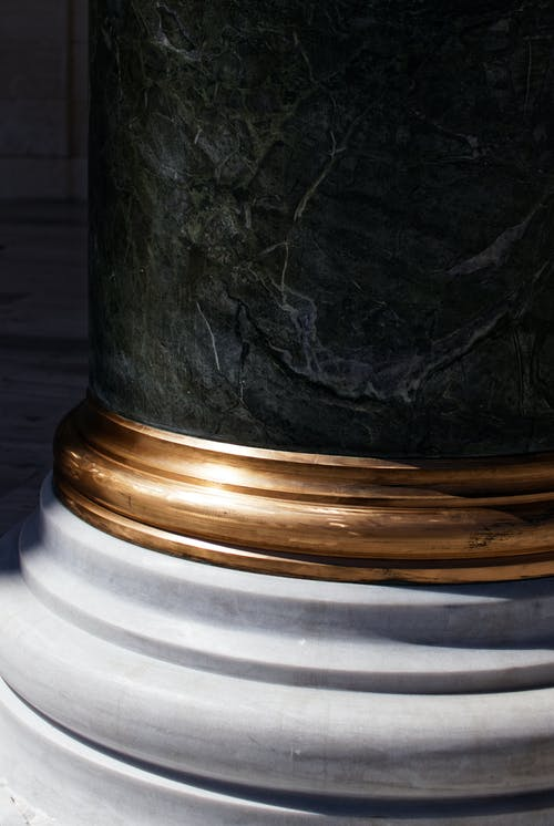 Black, Brass-colored, and White Pillar