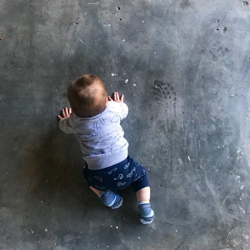 Free stock photo of baby, crawling, floor, garage