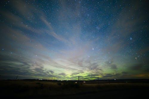 Aurora borealis, bulutlar, gökyüzü, ünlüler içeren Ücretsiz stok fotoğraf