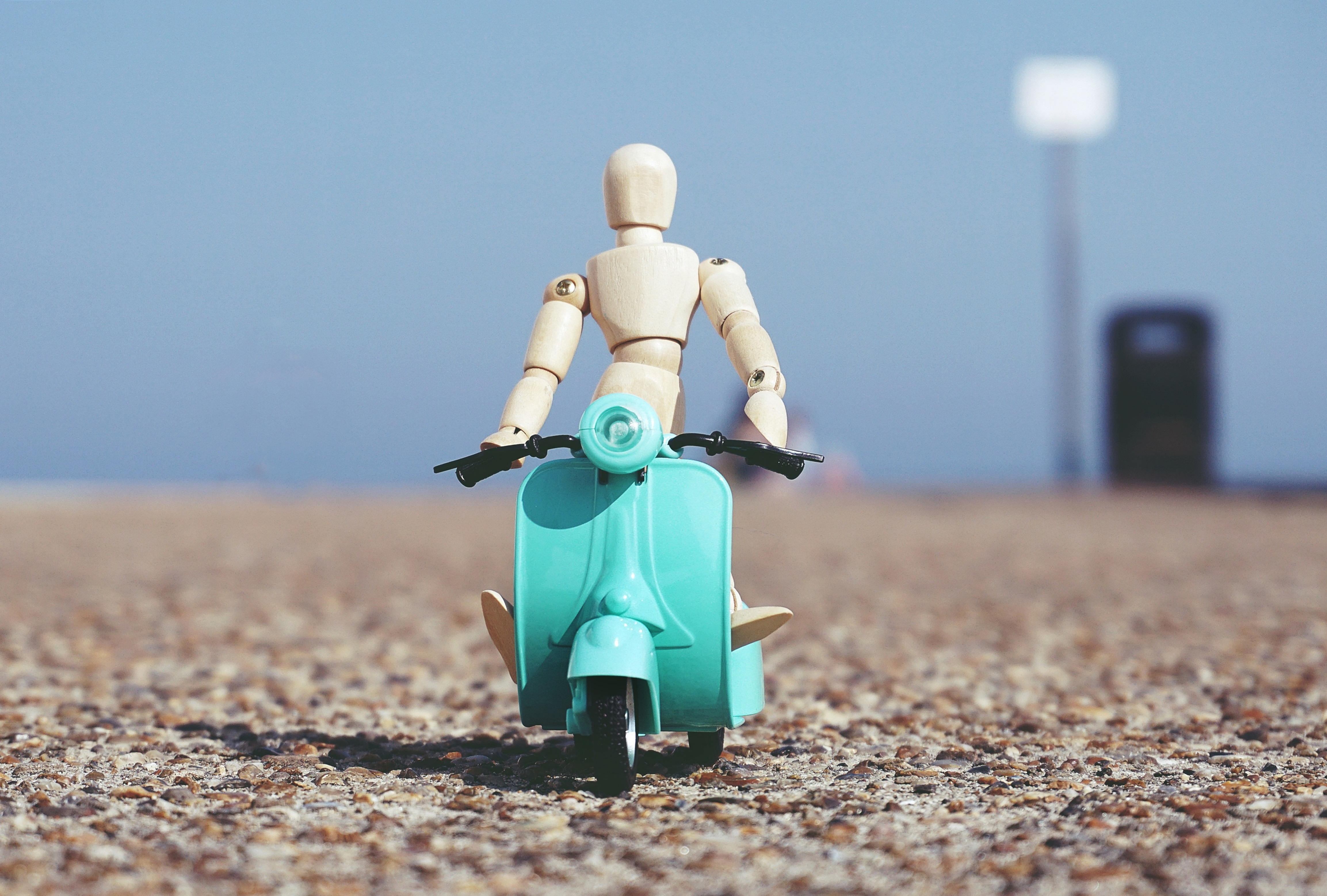 Robot Toy Riding A Scooter