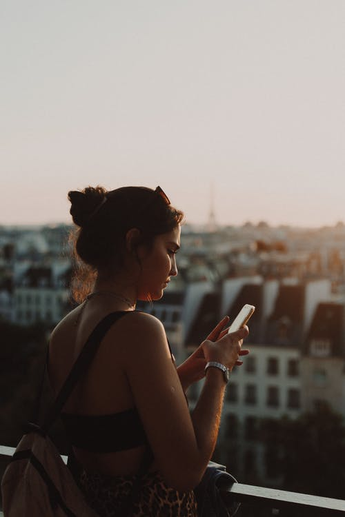 Photo Of Woman Holding Her Smartphone