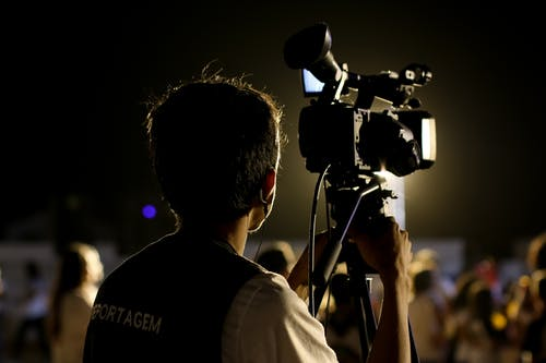 Shallow Focus Photo of Cameraman