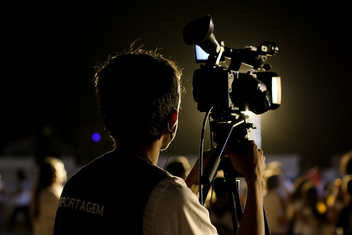 Shallow Focus Photo of Cameraman