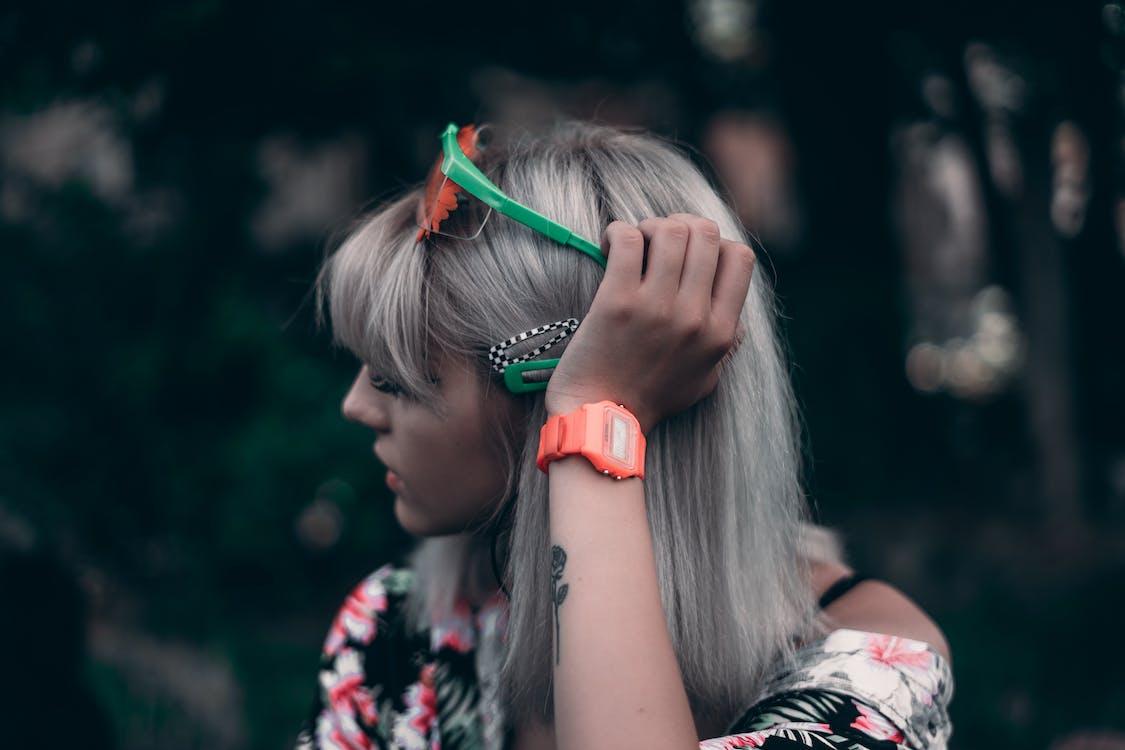 Photo Of Woman Wearing Orange Watch