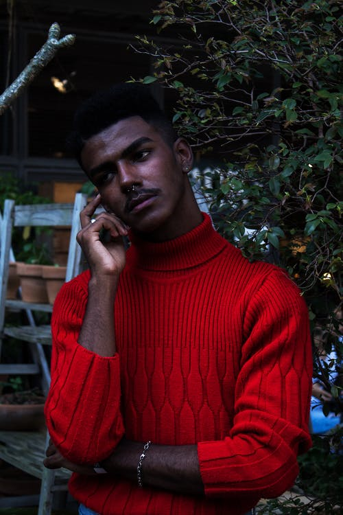 Man in Red Turtleneck Sweatshirt