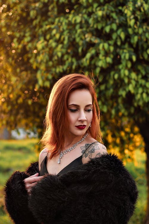 Photo Of Woman Wearing Black Fur Coat