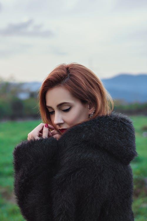 Woman Wearing Black Fur Coat