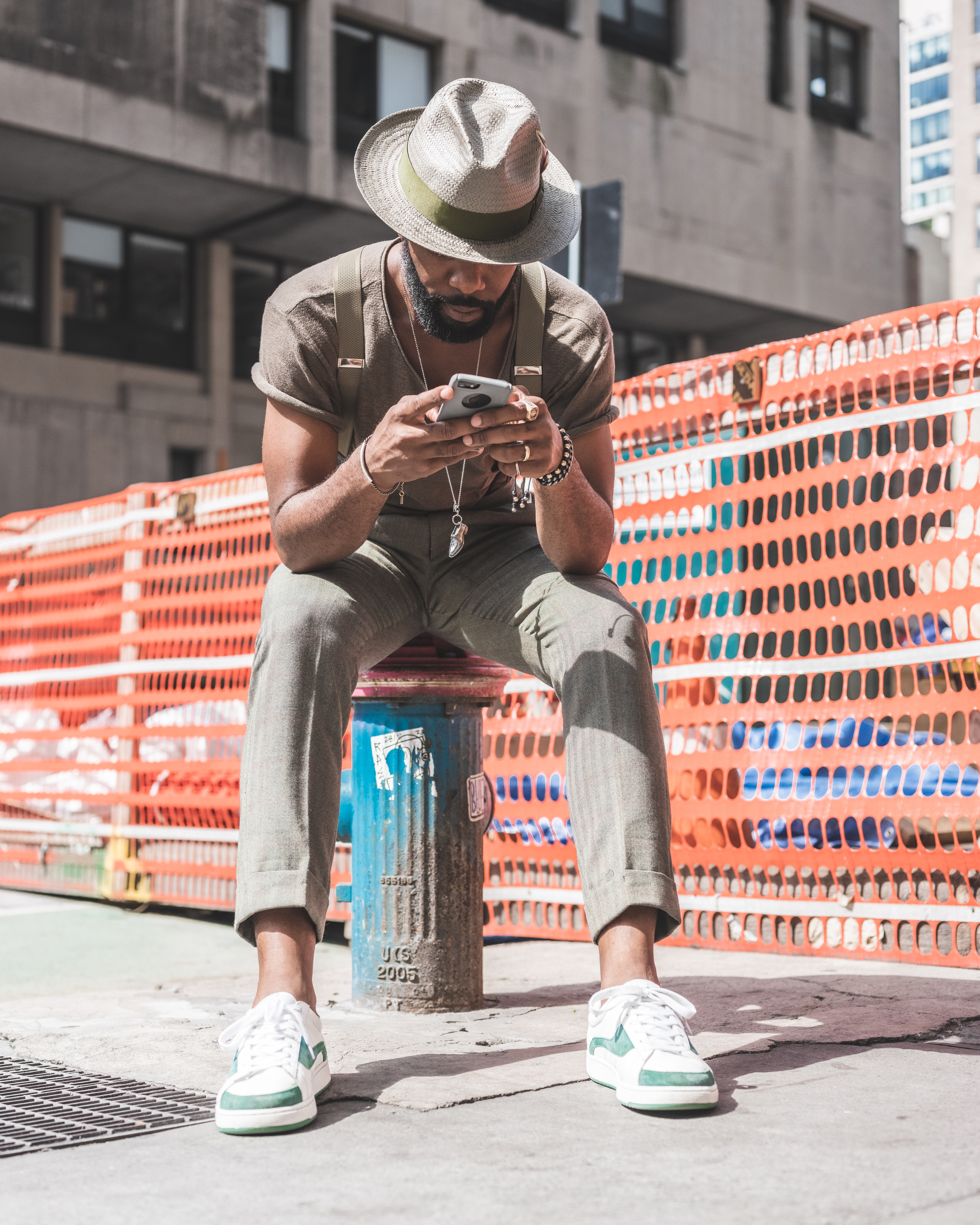 Photo Of Man Holding His Smartphone