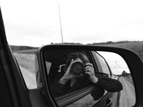 Person Taking Photo while on Car