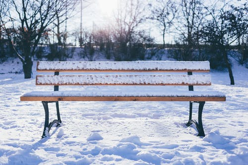 Brown Wooden Patio Bench on Snow