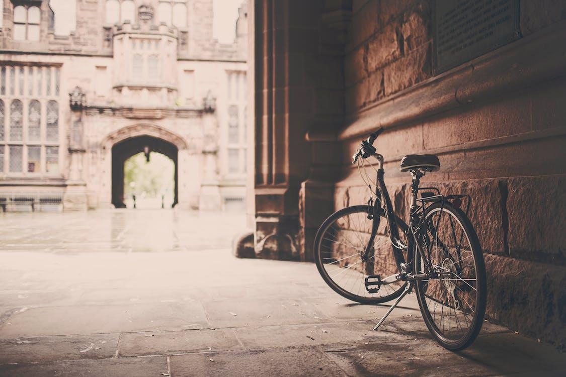 Bike Parked Beside Concrete Wall