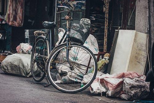 Black Commuter Bike Beside Trash