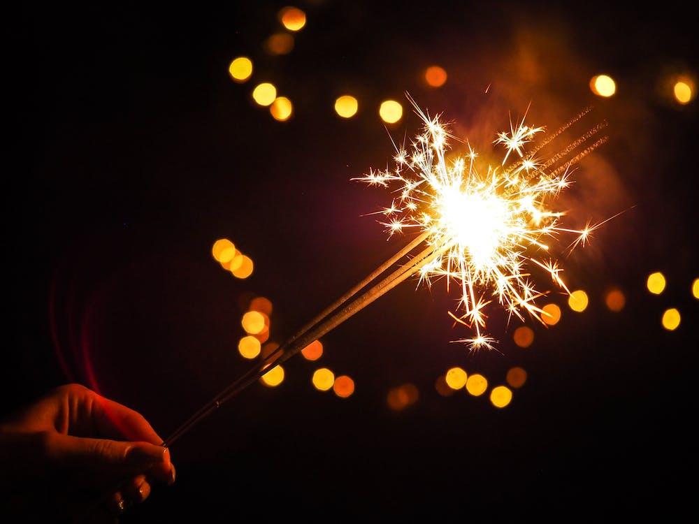 Person Holding Lighted Firecracker