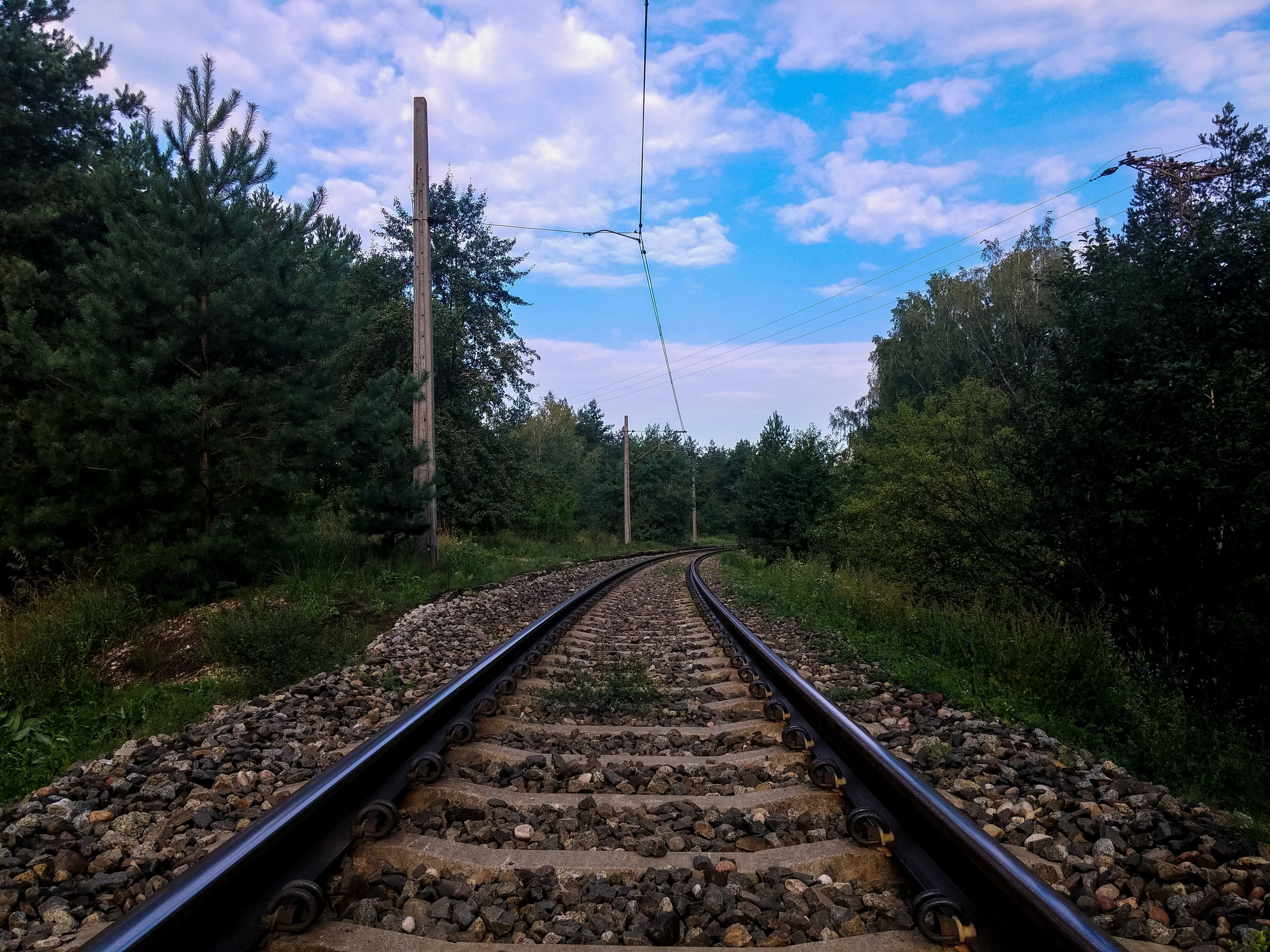 Free stock photo of blue sky, journey, low angle shot, railroad