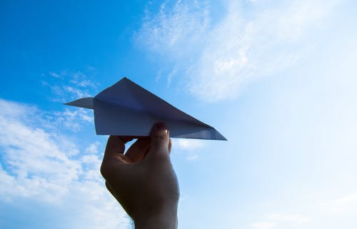 Free stock photo of blue, flight, hand, paper aeroplane