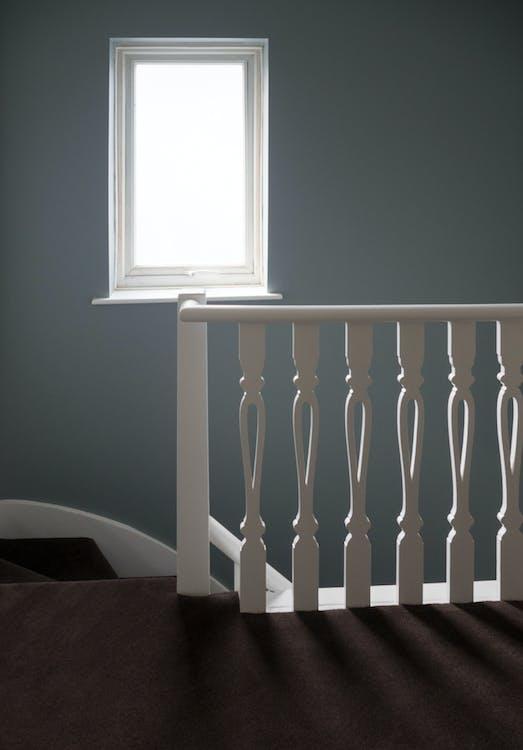 Photo of White Window Frame An White Wooden Stair Balustrade
