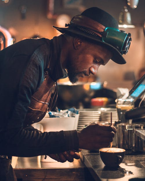 Man Making Cappuccino on Table