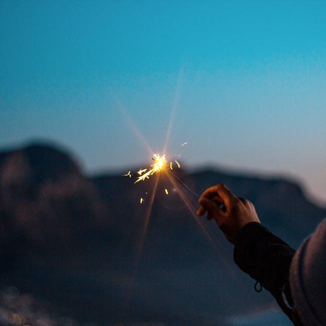 A lit flare light on hand