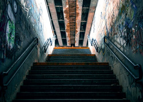 A Concrete Stairway With Steel Railings