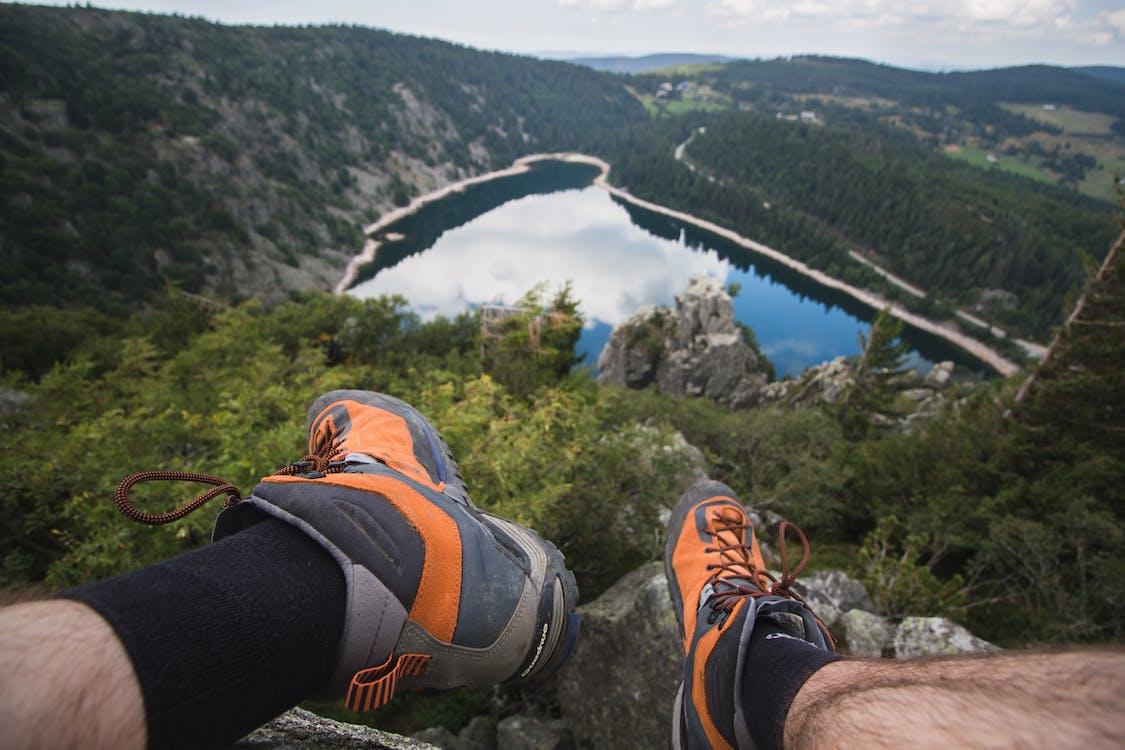 Man Sitting on Rock Looking at Lake