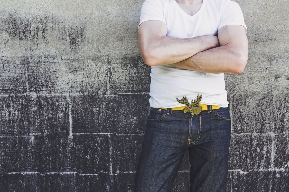 Man Leaning on Gray Wall