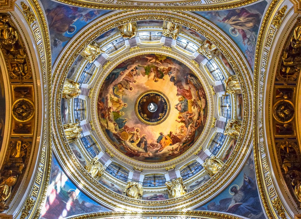 Religious Paintings On A Cathedral's Ceiling