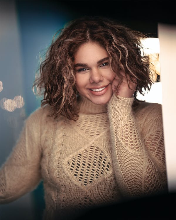 Woman Wearing Beige Knitted Turtleneck Sweater Smiling