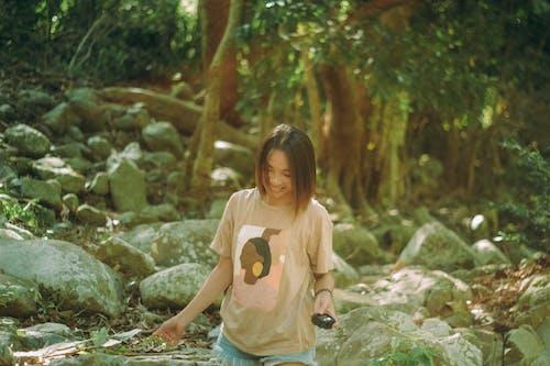 A Woman Standing Beside Rocks